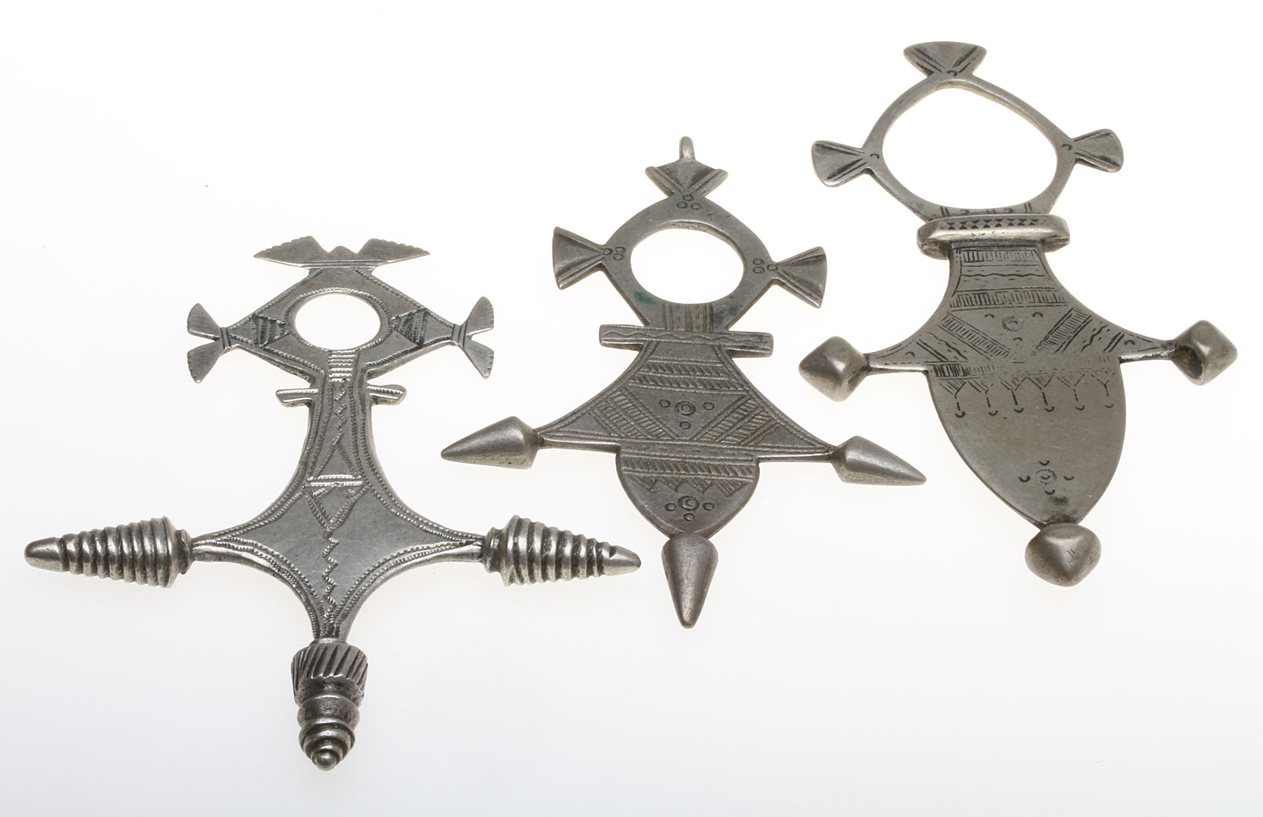Vintage cast silver crosses of Agadez and Iferwane, that have been tooled, primarily with chasing; they are 7.0 to 8.4 cm high. For additional information, see Ornament 40/3, 2018.  Courtesy of J. Busch.  RKL