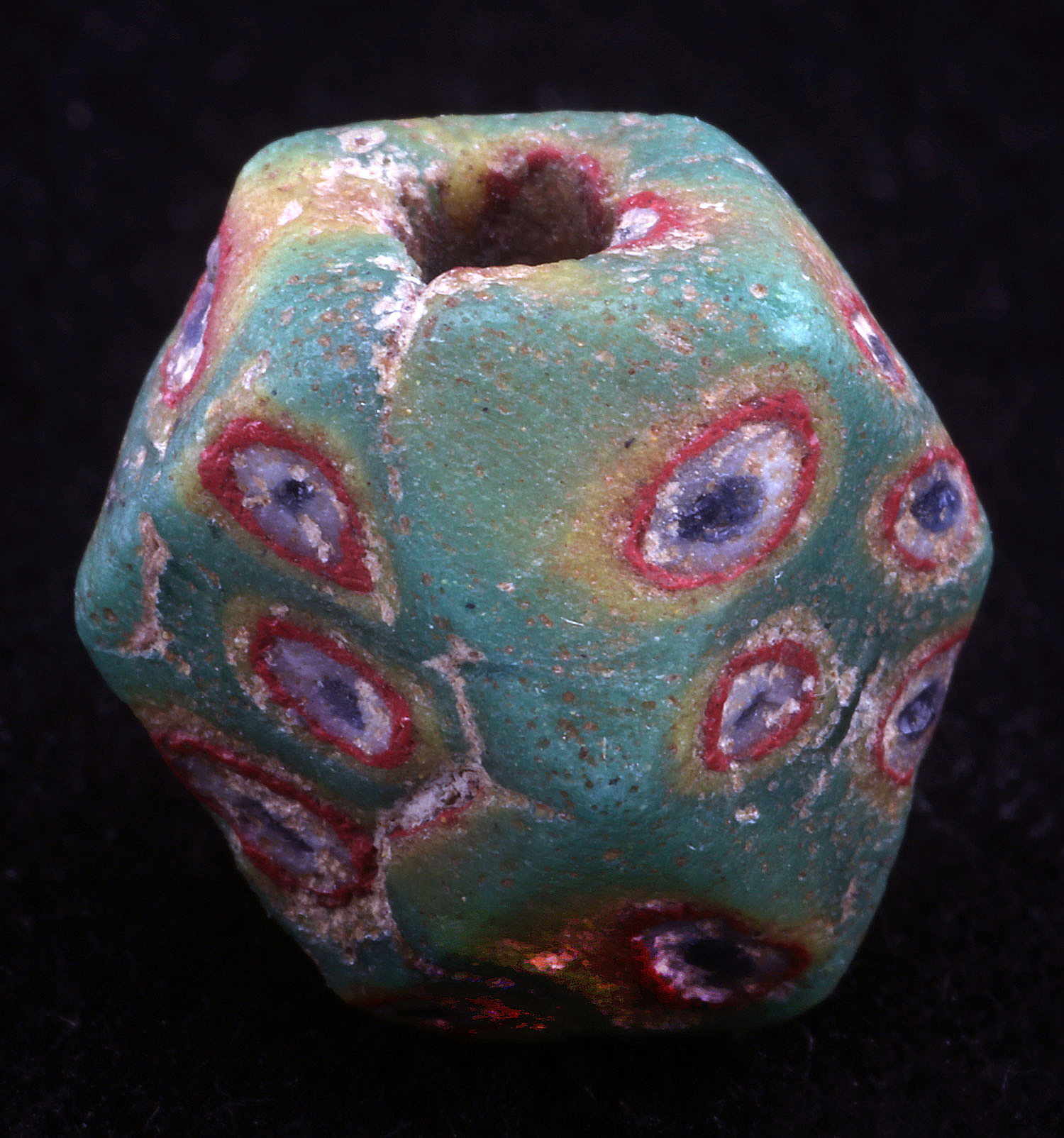 Islamic period cornerless cube bead with mosaic decoration, 1.2 cm high.  Courtesy of the late Rita Okrent.  RKL