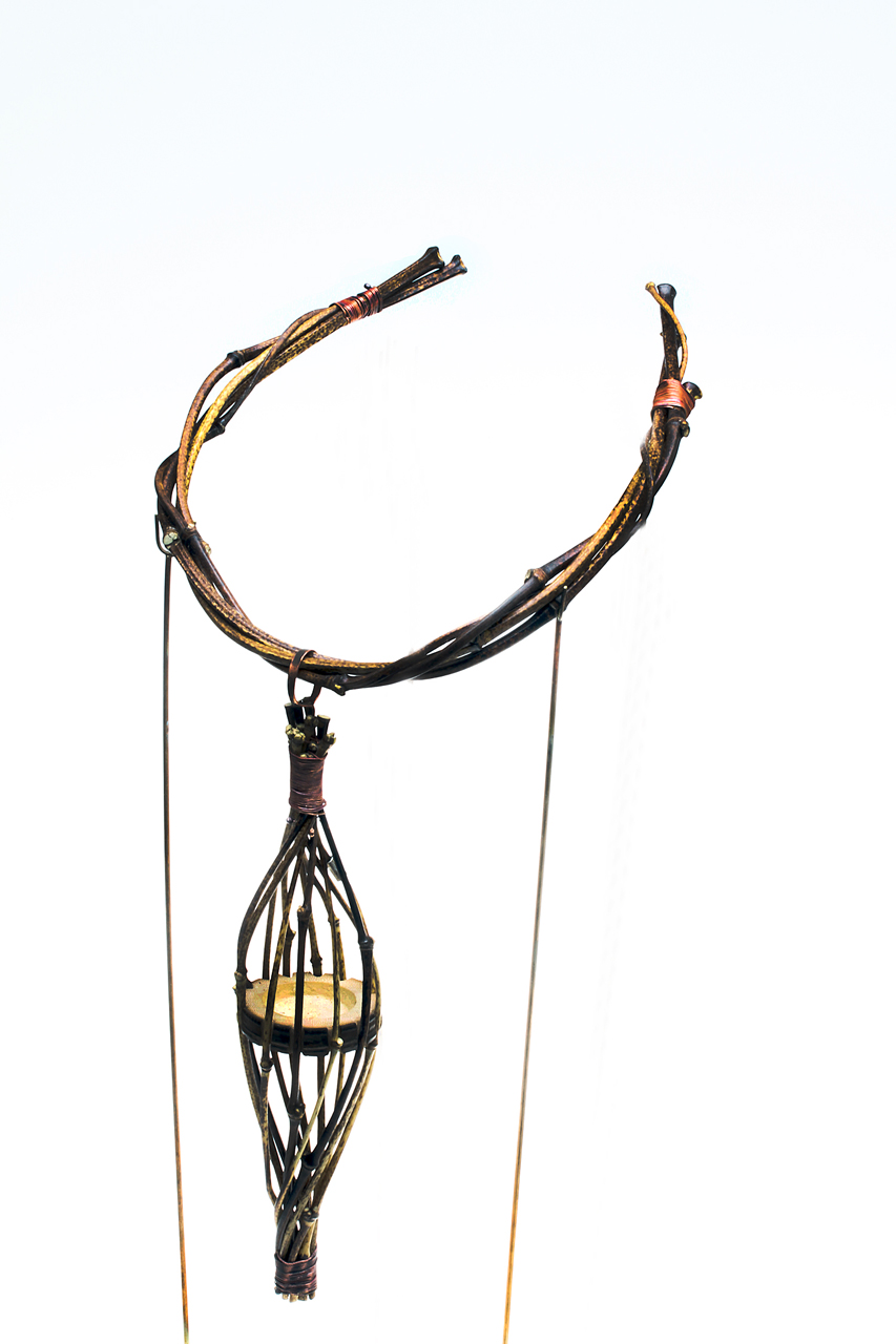 FINISHED PENDANT AND TORQUE, with wire-wrapped near ends of intertwined torque. Pendant is 17.0 cm long, torque 12.5 cm wide. Neckpiece is held in 2 rod arms of armature for photography.