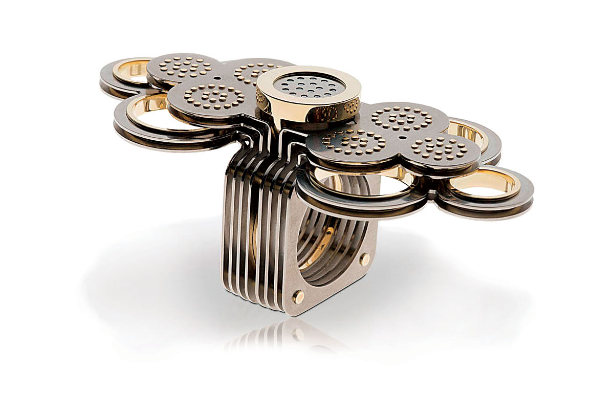 FIRST PLACE   ALTERNATIVE METALS/MATERIALS. Gabri Schumacher, The Netherlands, Head In The Clouds ring of titanium, gold and diamonds.
