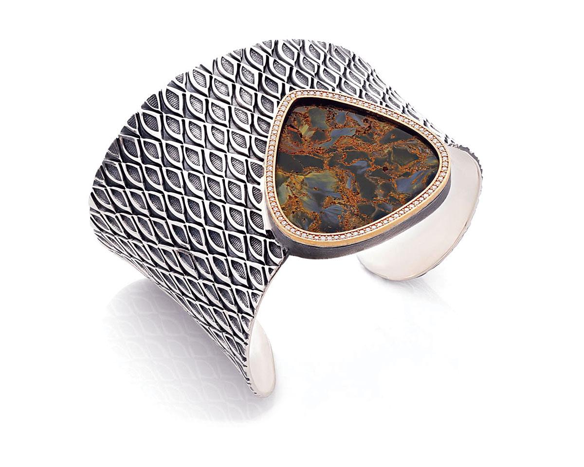 FIRST PLACE SILVER/ARGENTIUM® SILVER.   Matthieu Cheminée, Canada, Itado bracelet of sterling silver, eighteen karat gold, pietersite, and diamonds.