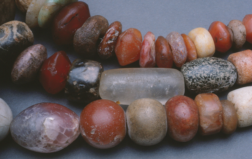 Carnelian beads from ancient Cambay, India, collected in Africa with some crystal and possibly indigenous granitic beads.
