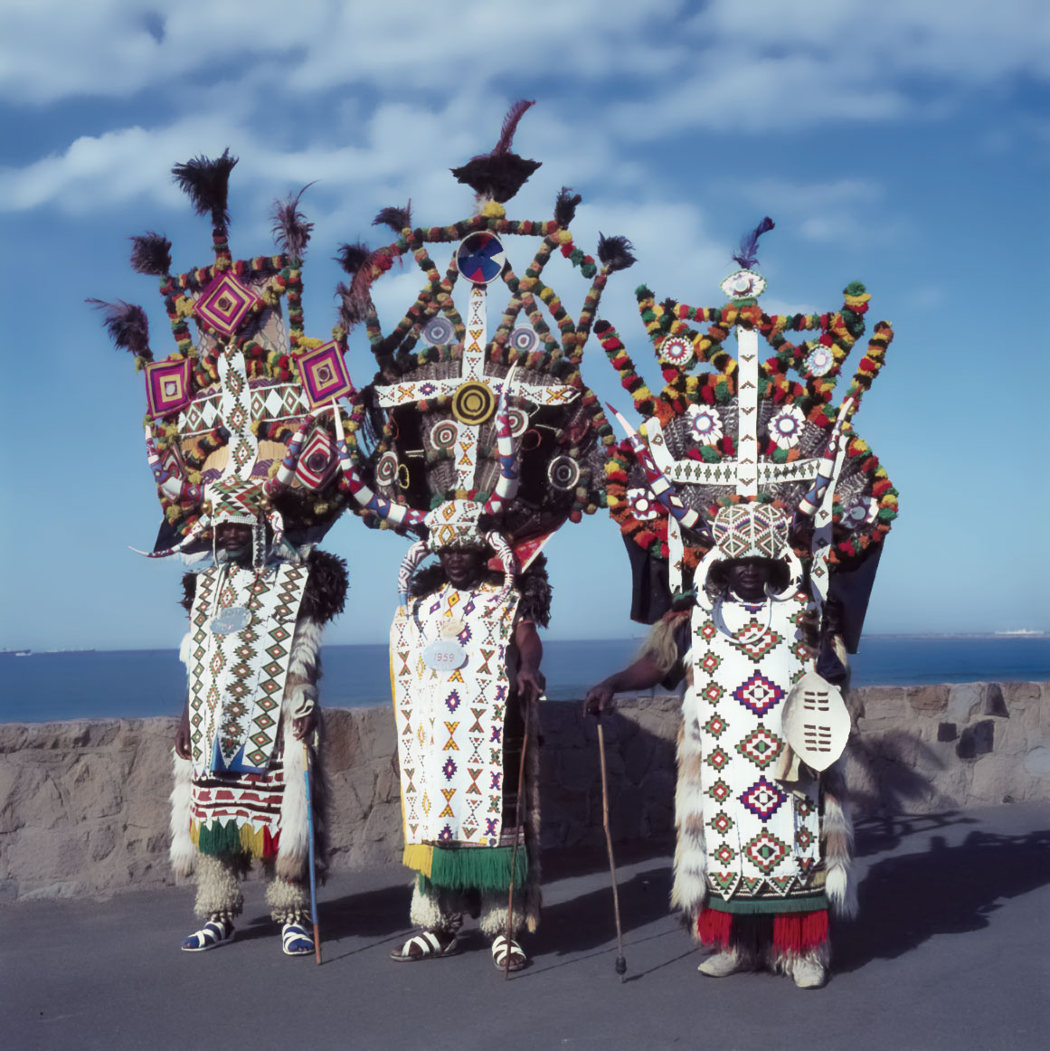 ZULU RICKSHAW PULLERS ON THE BEACHFRONT, Durban, South Africa, early 1980s.  Photograph by Jean Morris.
