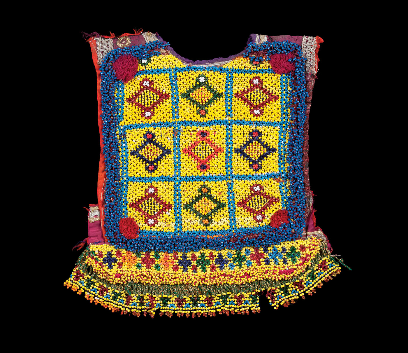 CHILD'S BLOUSE PANEL, northern Afghanistan, of cotton, glass beads, 38.0 x 32.7 centimeters, twentieth century.  Anne and Bill Frej Collection.