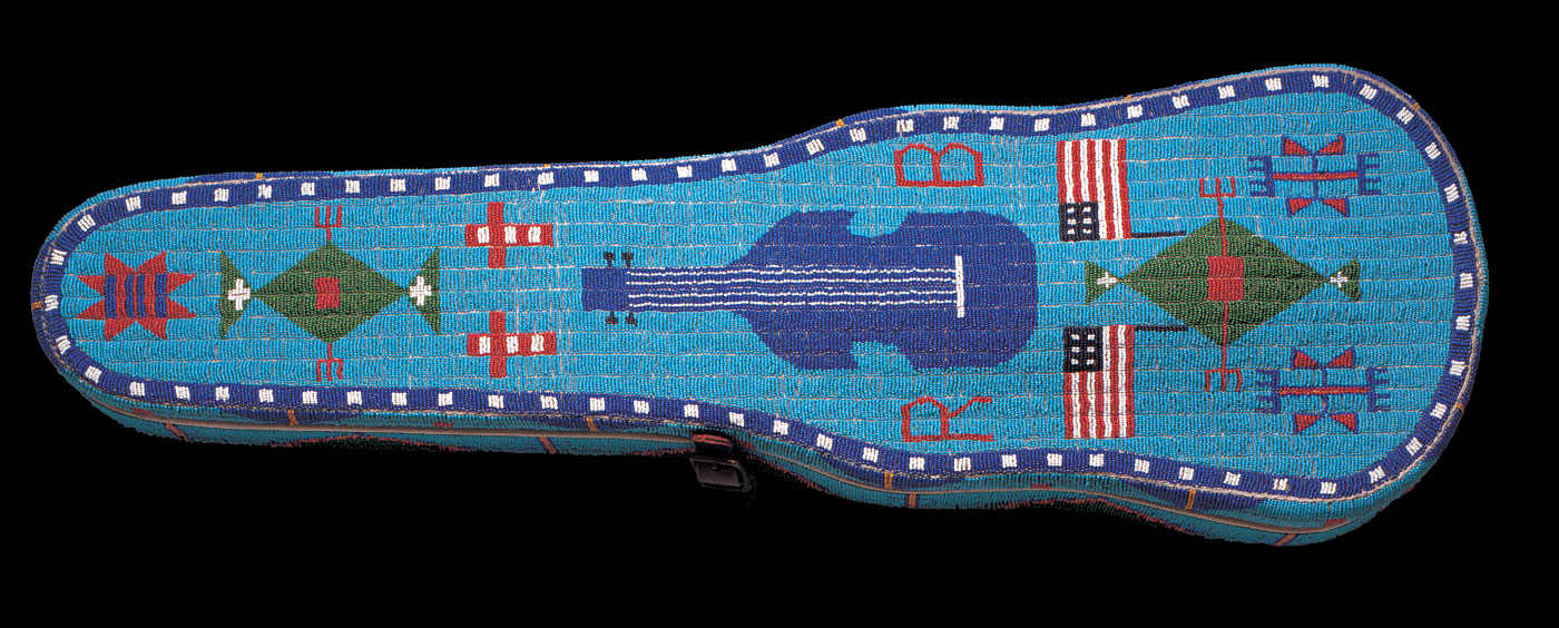 VIOLIN CASE, Brulé Lakota, Rosebud Indian Reservation, South Dakota, of commercial wood case, native-tanned hide, metal trim, glass beads, 81.3 x 25.4 x 11.4 centimeters, 1891.  Courtesy of Stars and Stripes Foundation.