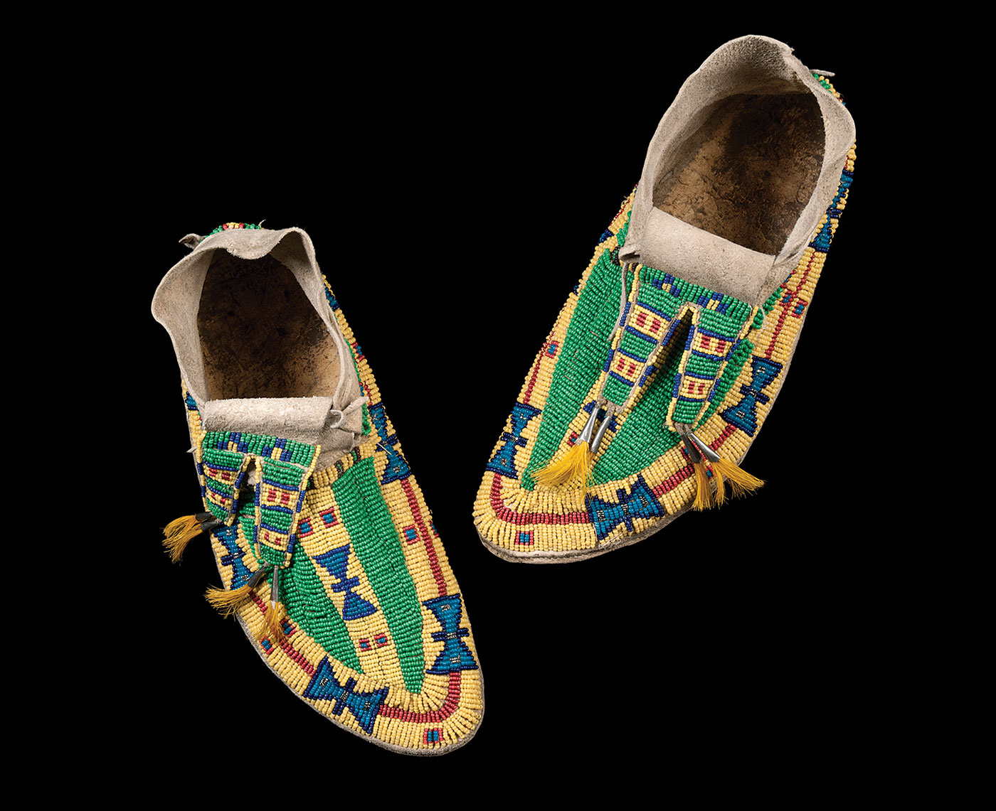 Beadwork Adorns the World:  WEDDING MOCCASINS FOR BRIDE'S IN-LAWS, Lakota peoples, North or South Dakota, of tanned hide, glass beads, 26.7 centimeters, circa 1930.  Photograph by Blair Clark.