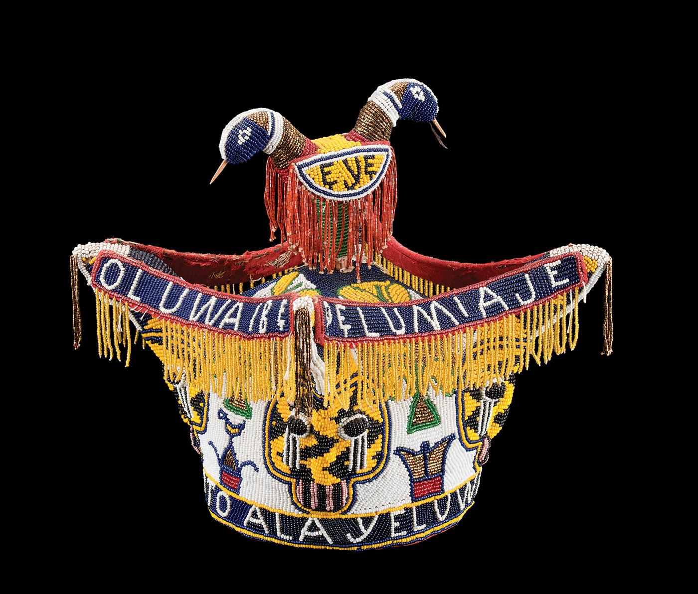 Beadwork Adorns the World:  OBA'S BRITISH CROWN-STYLE CORONET, Yoruba peoples, southwest Nigeria, of cotton, glass beads, diameter: 16.0 centimeters, mid-twentieth century.  Photograph by Blair Clark.