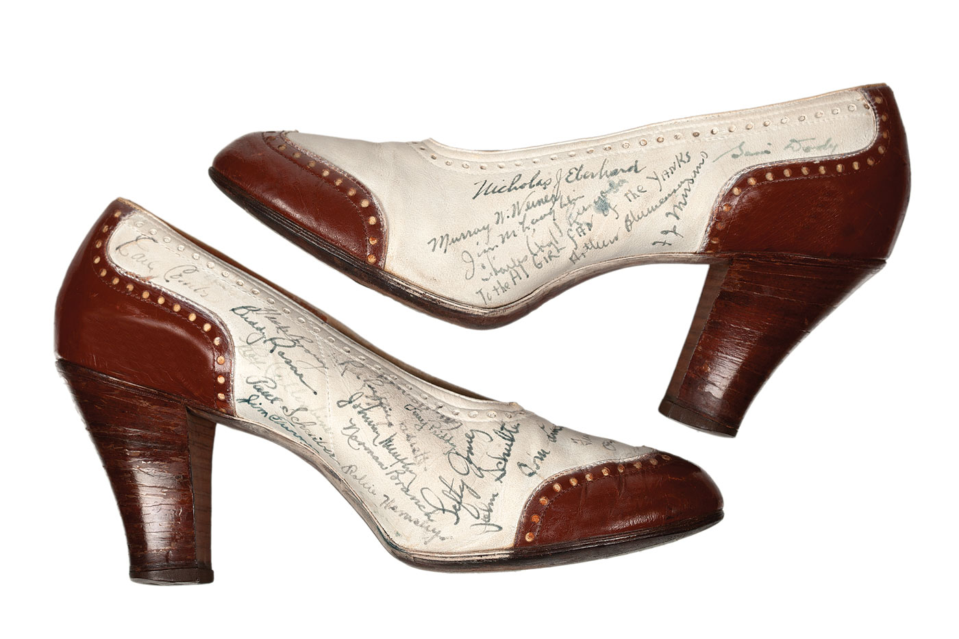 Walk This Way:  SPECTATOR PUMPS of leather, circa 1936. During Joe DiMaggio's rookie year with the Yankees, he had his teammates sign a pair of his girlfriend's shoes. Twenty-seven players autographed this otherwise ordinary pair of pumps. Fourteen of the players were future winners of the 1941 World Series.