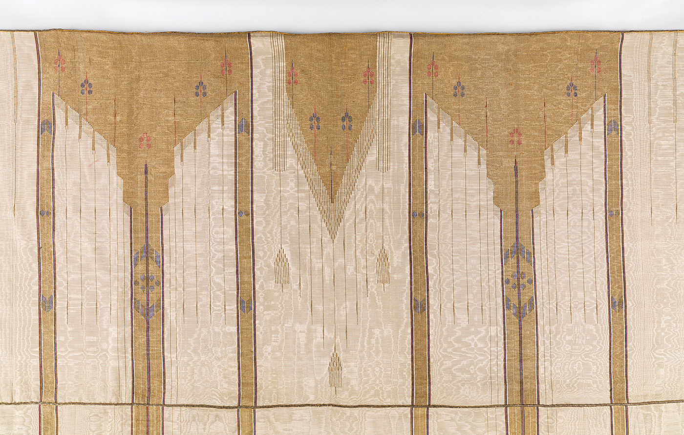 Dressed with Distinction:  MAN'S CLOAK (abaya) of silk, cotton, metallic thread, weft-faced weave, slit tapestry technique, early twentieth century.