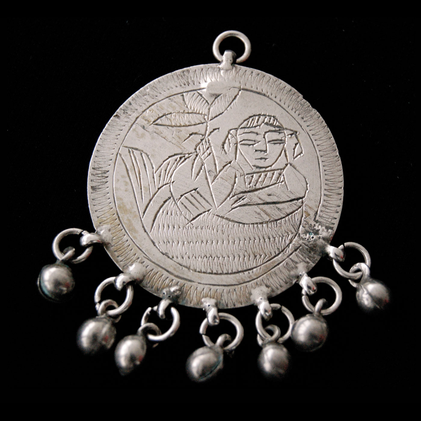 Egyptian Zar Jewelry:  SILVER ZAR PENDANTS FEATURING THE MERMAID SPIRIT SITT SAFINA; 1933.  Photograph by Sigrid Van Roode.