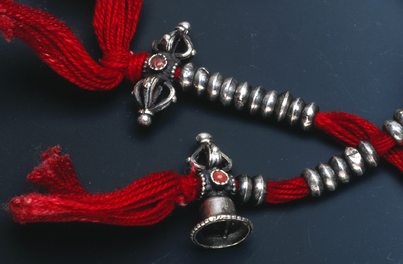 Nepalese silver dorje, along with counters, on a prayer strand or mala. RKL