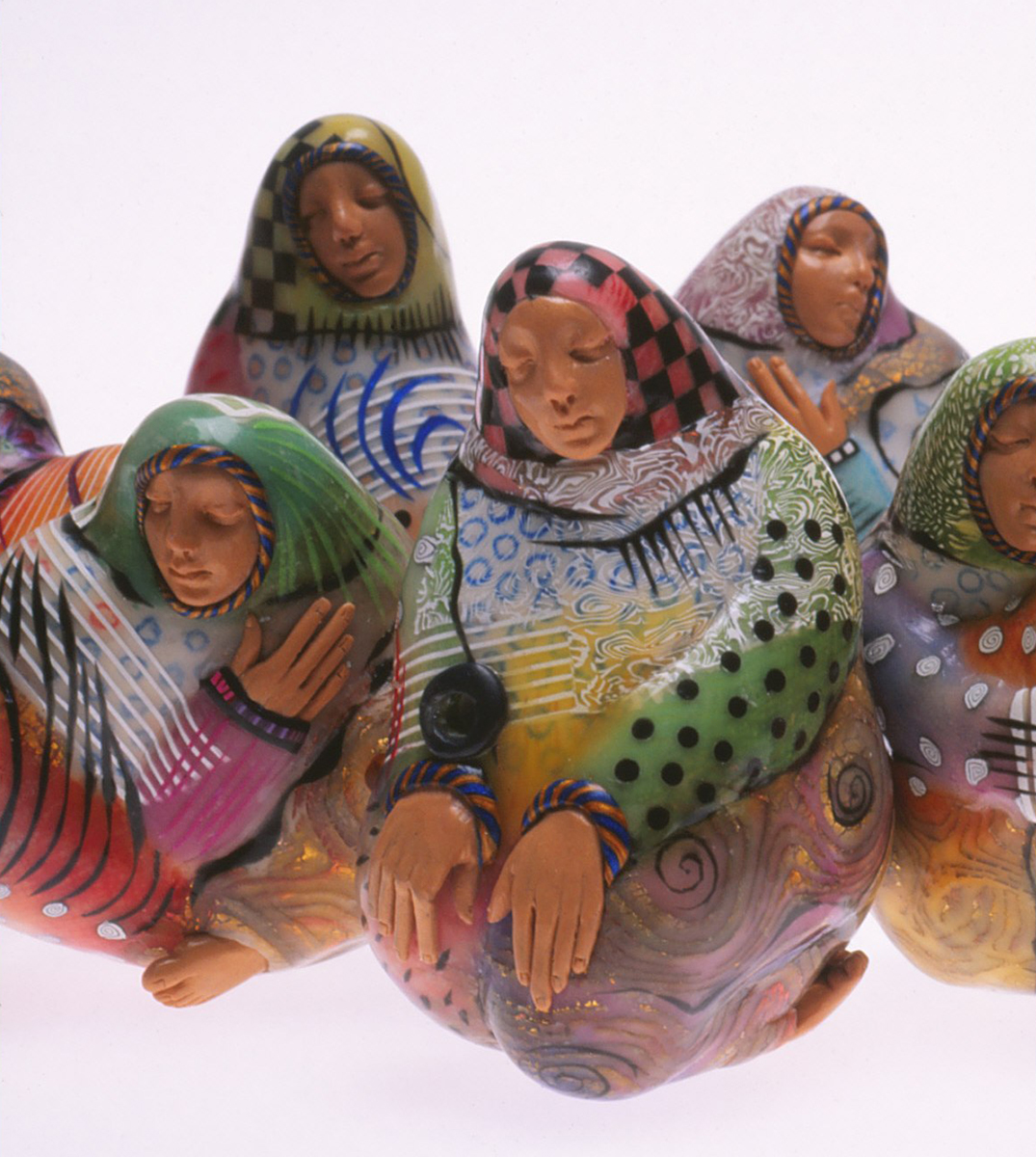 Closeup of other Village Women beads, arranged in a tableau. RKL