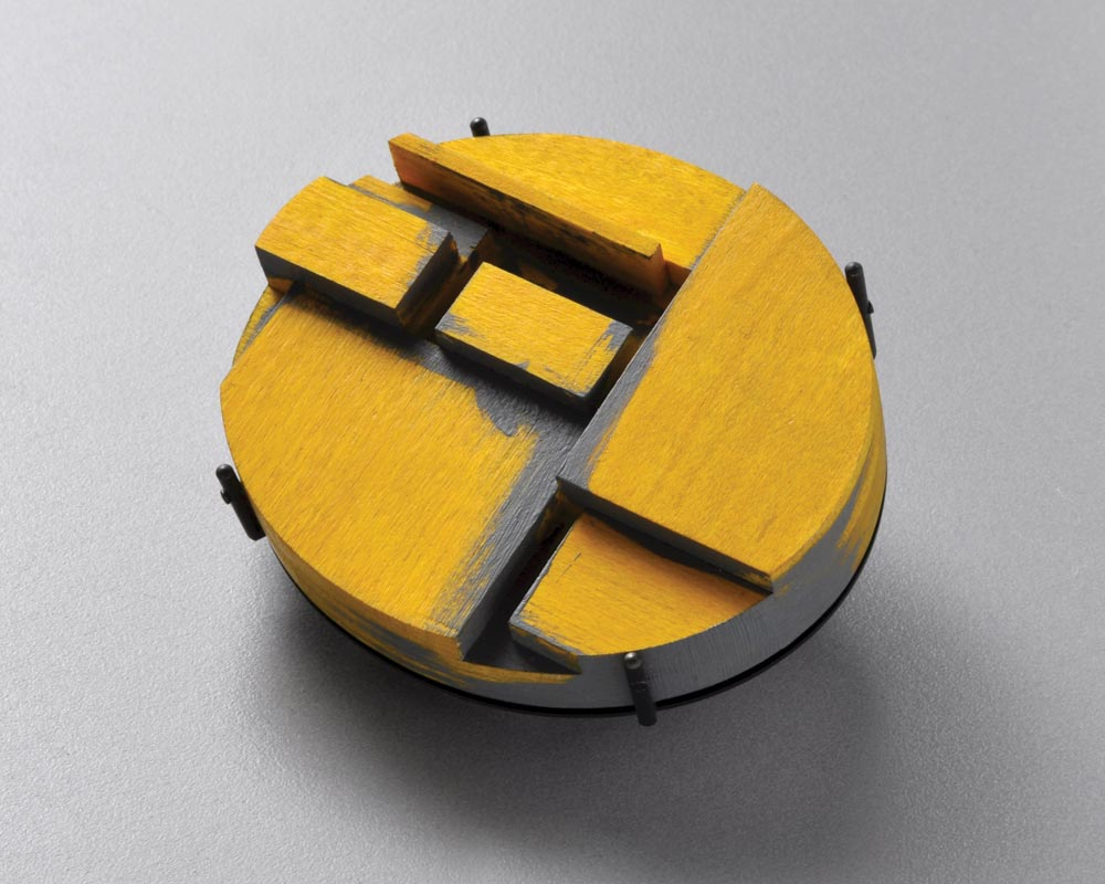 Julia Turner:  STACK BROOCH #2, YELLOW, of maple, stain, gesso, steel, 6.0 x 5.0 x 1.4 centimeters, 2016.