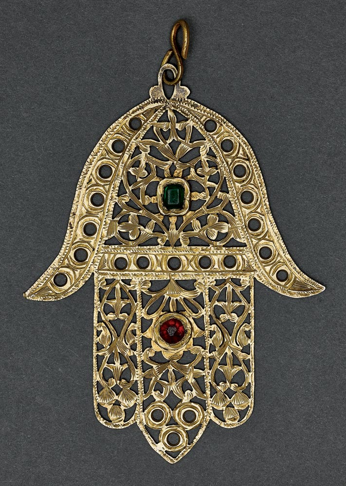 HAMSA AMULET  of silver, gilt, Fez, Morocco, circa 1930.  Photograph by Ardon Barhama. Gross Family Collection. Images courtesy of the Museum for Islamic Art, Jerusalem.
