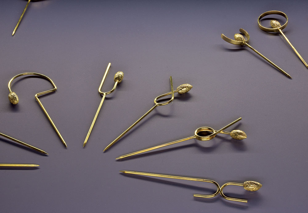 INSIGNIA: 50 SHADES OF PATRIARCHY LAPEL PINS  by Rami Tareef, of silver, brass, gold; lost-wax casting, soldering, sawing, bending, gilding, 10.0 x 5.0 x 1.0 centimeters, 2019.