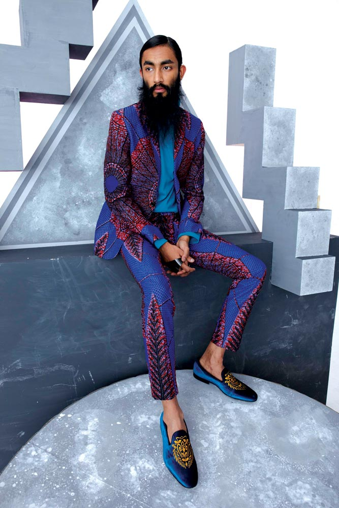 ALEXIS TEMOMANIN, DESIGNER FOR DENT DE MAN. LES TOILES D'ARAIGNÉE: MAN'S SUIT  in wax print by Vlisco, the Netherlands, 2016.  Courtesy of Dent de Man, London, UK. Photograph by Marc Hibbert.
