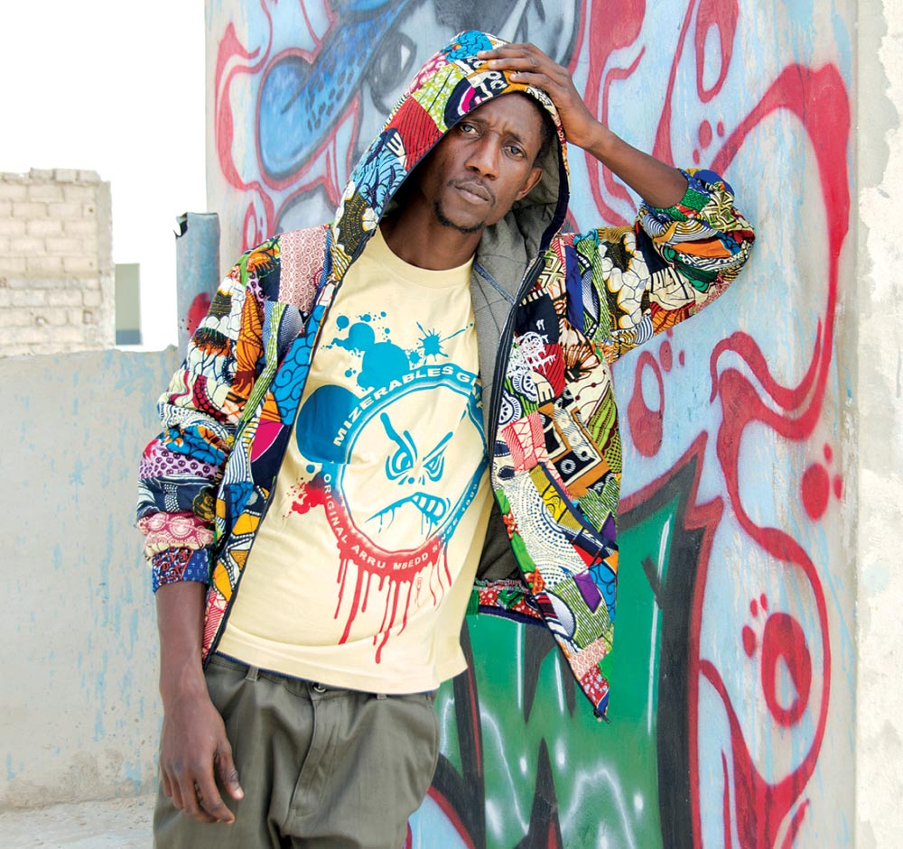 DEEP DAKART, DESIGNER FOR MIZÉRABLES GRAFFF. HOODIE AND T-SHIRT  of African-print cloth, 2016.  Photograph by Leslie W. Rabine.