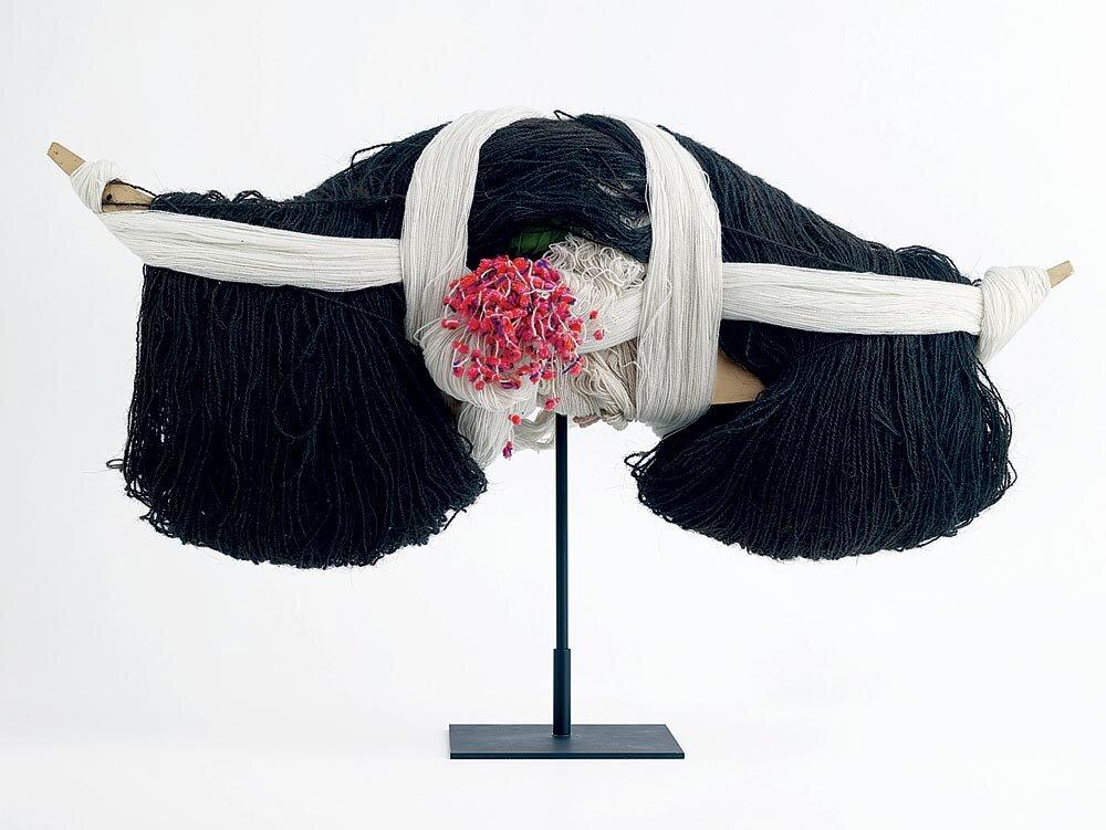 MUSÉE DES CONFLUENCES:  Headdress from Guizho, China.  Photograph by Pierre-Olivier Deschamps.