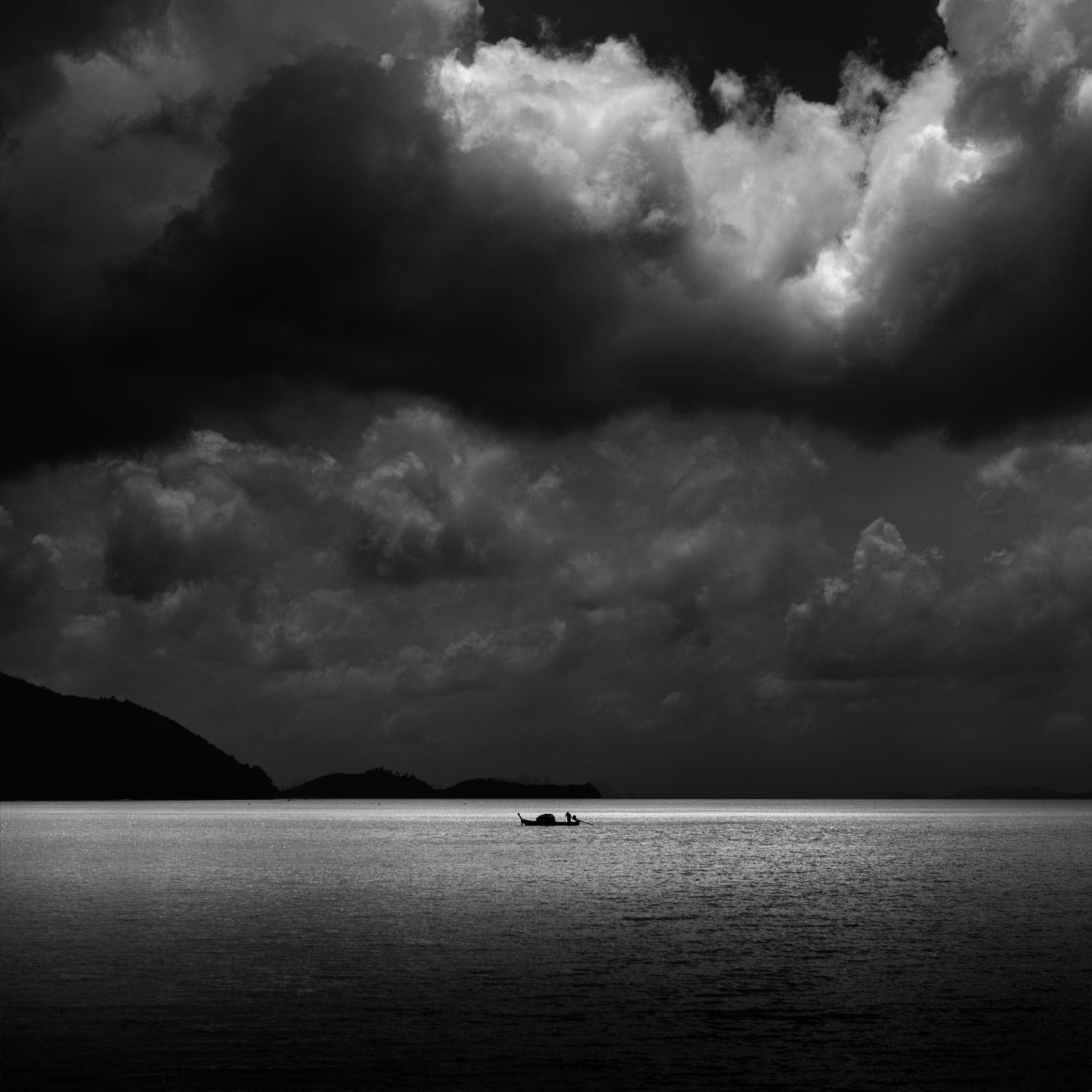 A lone fisherman plies his trade in the seas around Phuket, Thailand.
