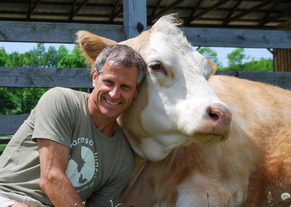 Gene with one of his rescued cows.