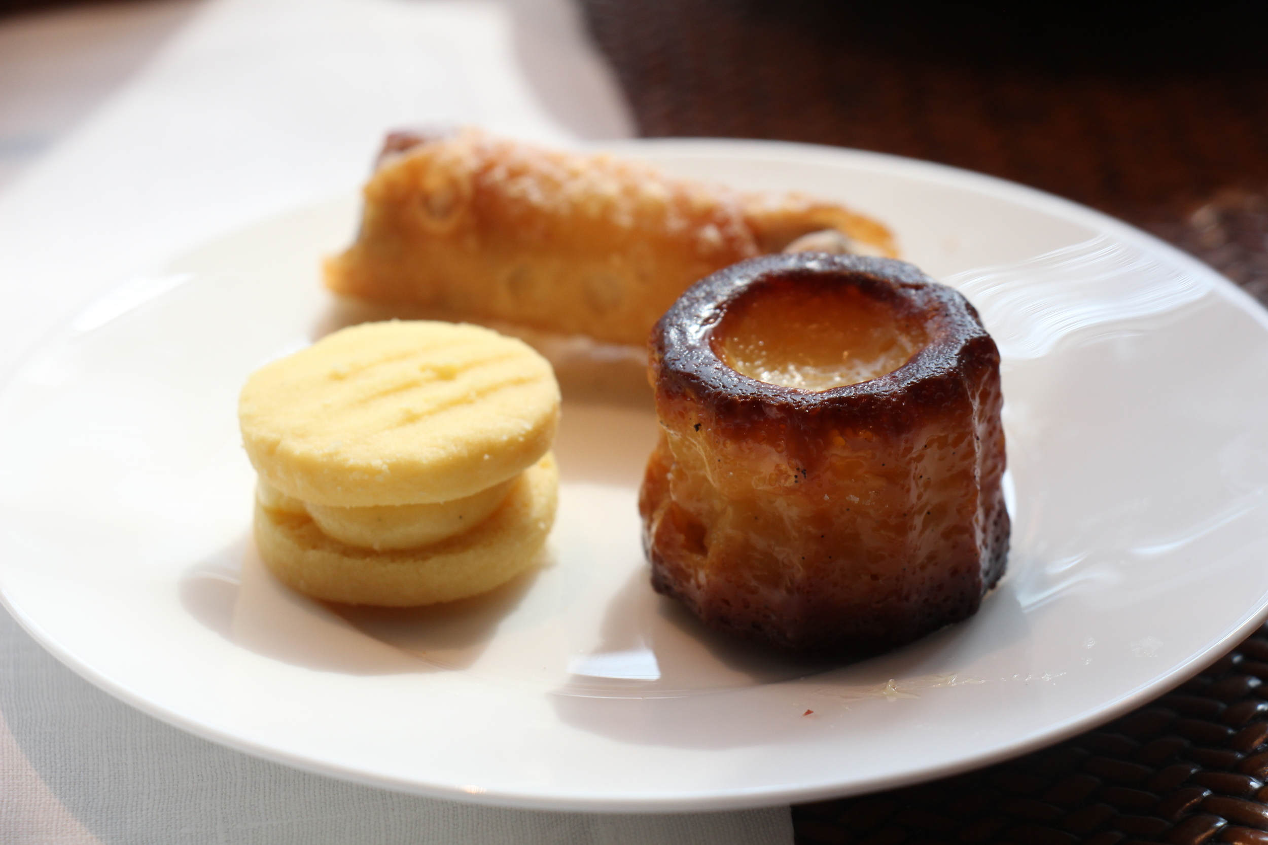 Left: Yoyo Biscuit; Right: Canelé.; Back: Canoli