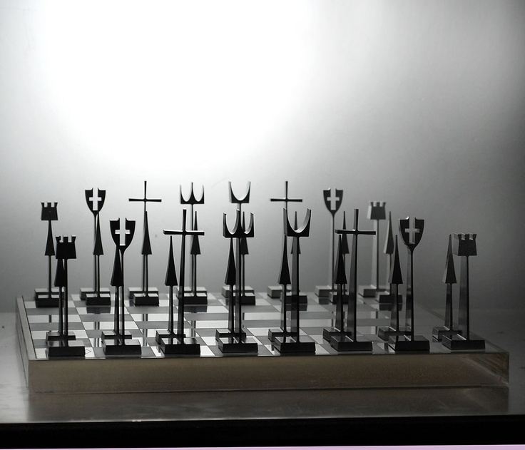 Chess set made from aluminum as a gift to Alcoa customers, 1962. Designed by Austin Cox.