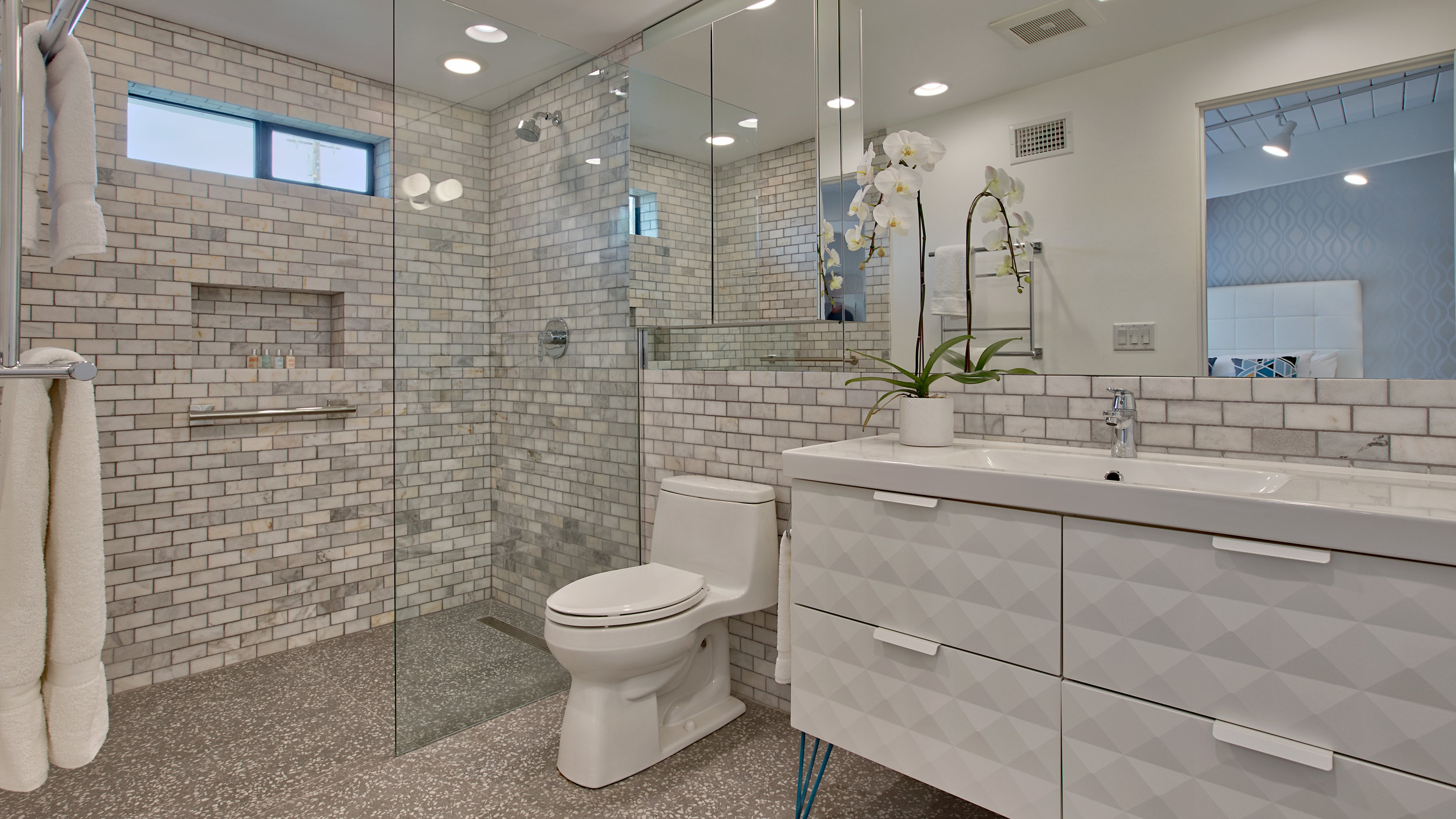 Master #2 private bathroom. Marble tile, barrier free walk-in shower, large vanity....lots of room!