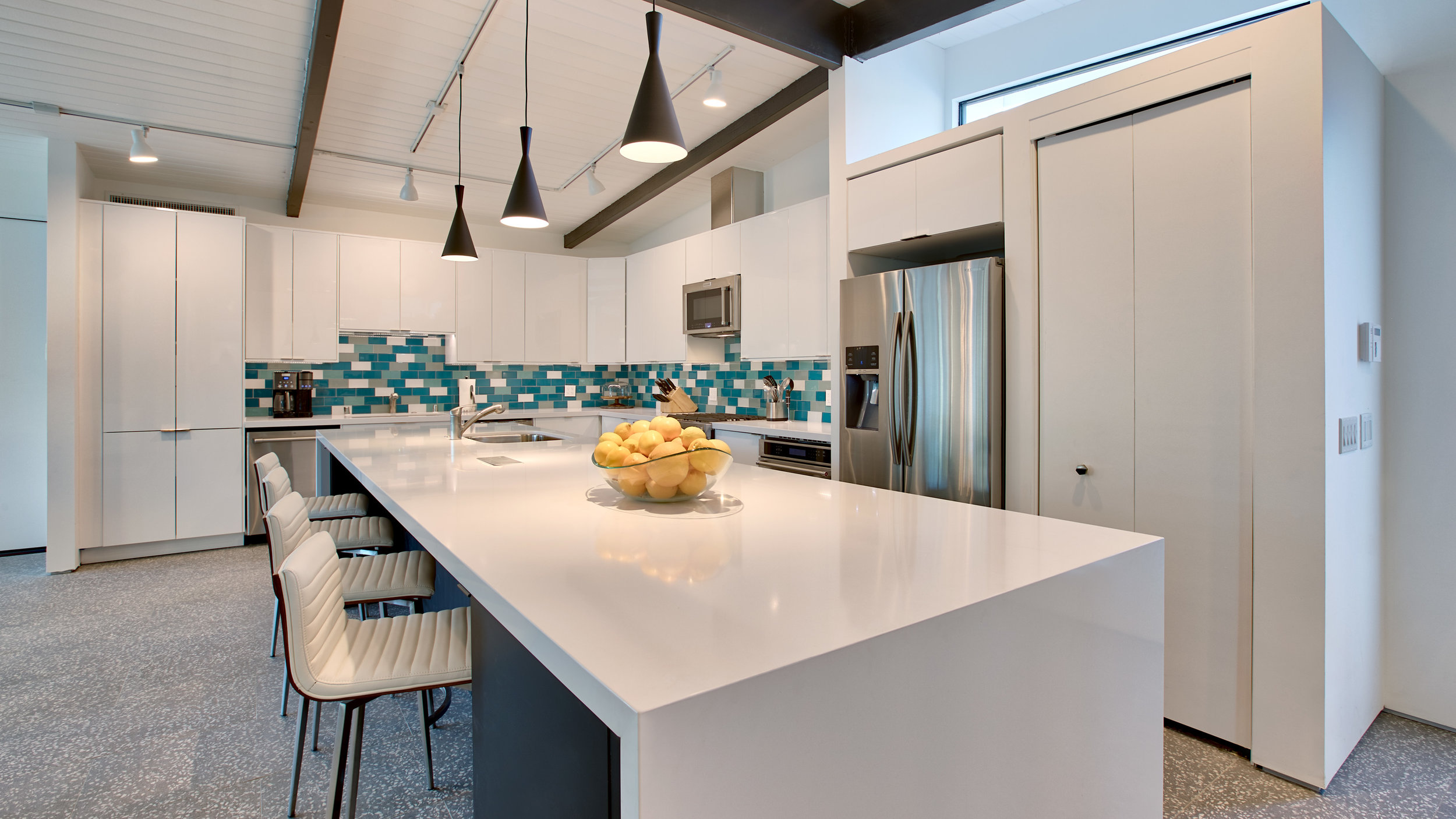 Chef's kitchen with quartz counters and 14' island. Full stocked, you'll never want for a thing!