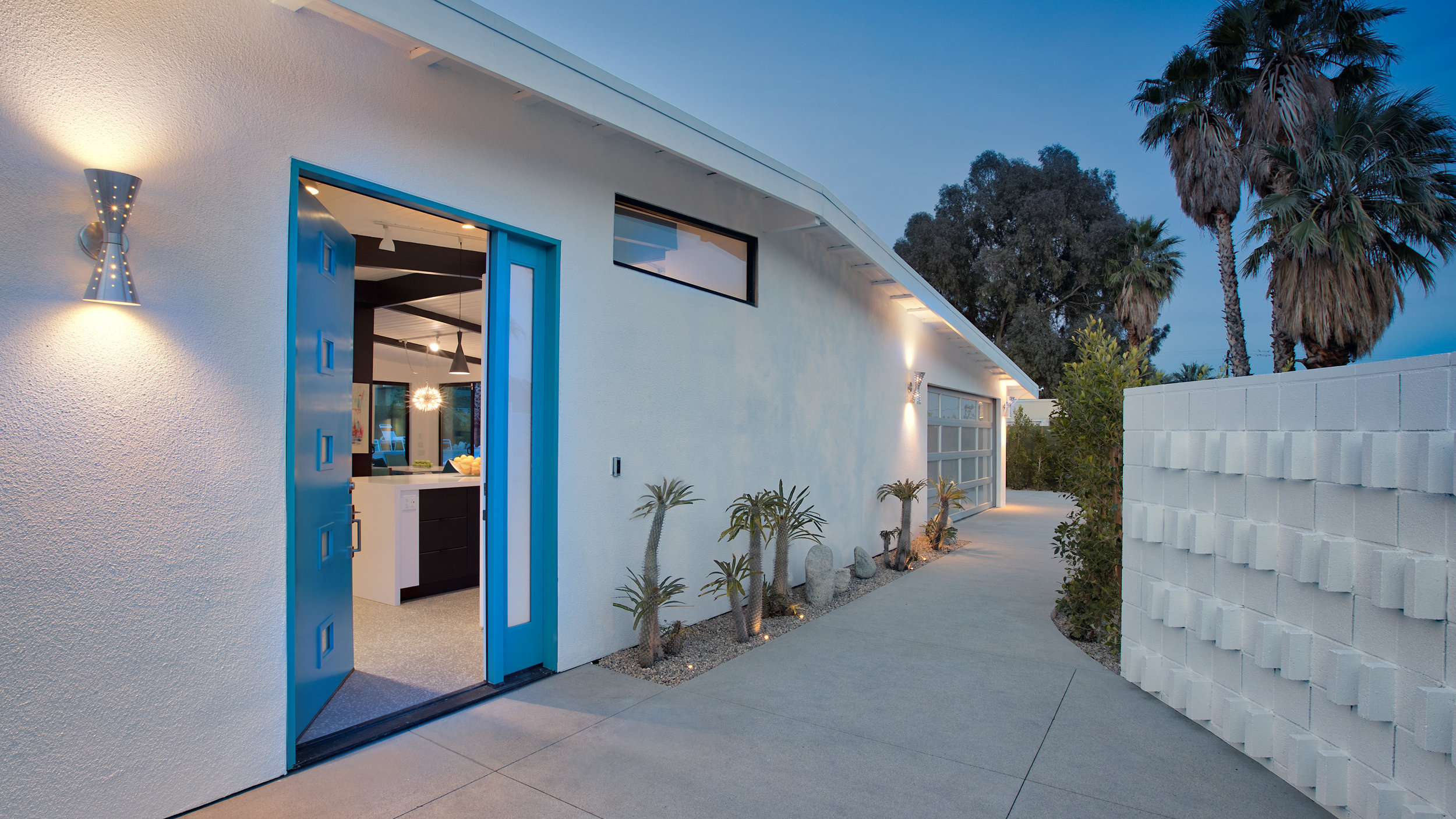 Welcome, come on in! Beautiful mid-century turquoise front door with private screenblock wall entry.