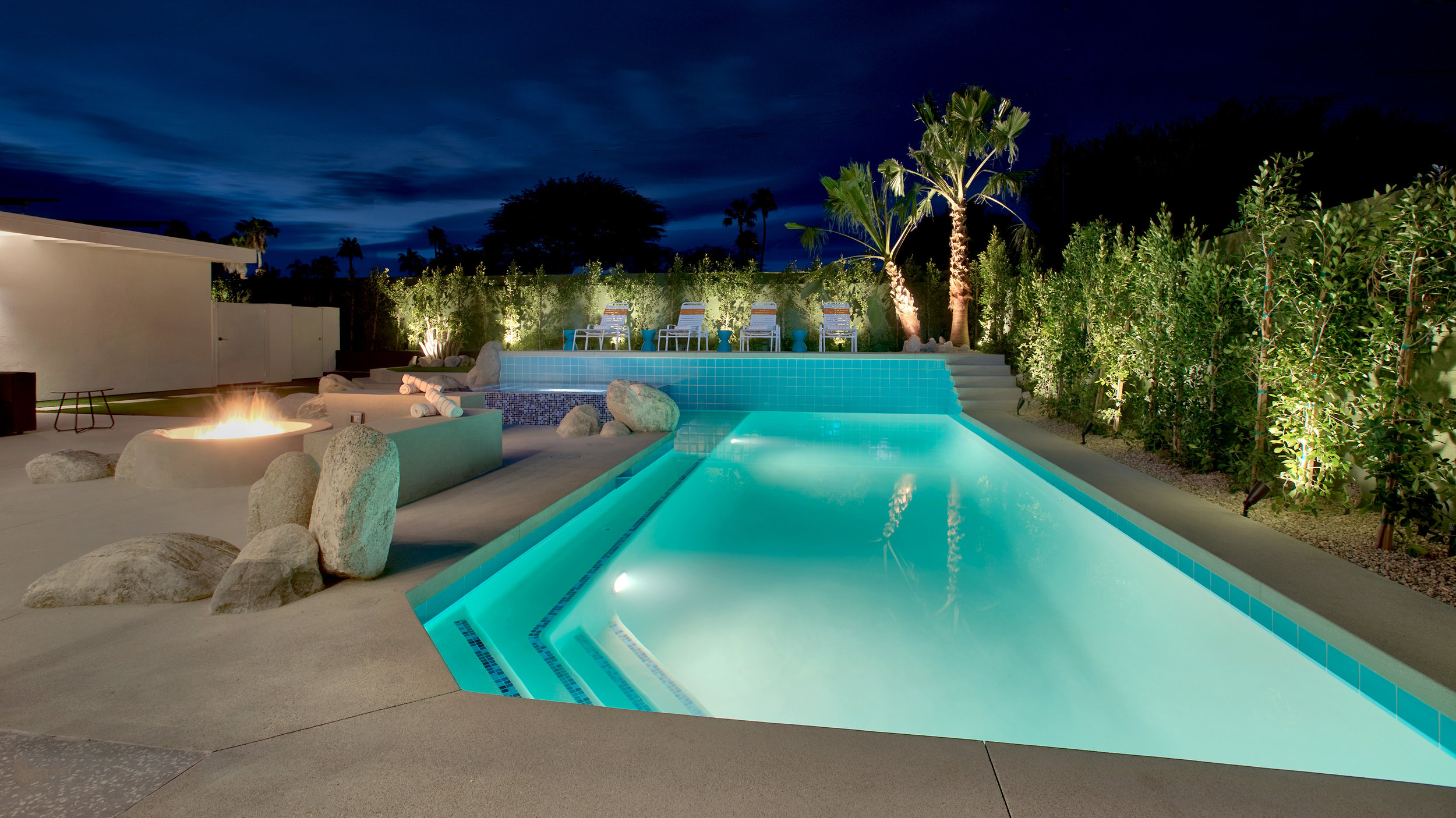 New salt-water pool with seating bench, tanning shelf and spa.