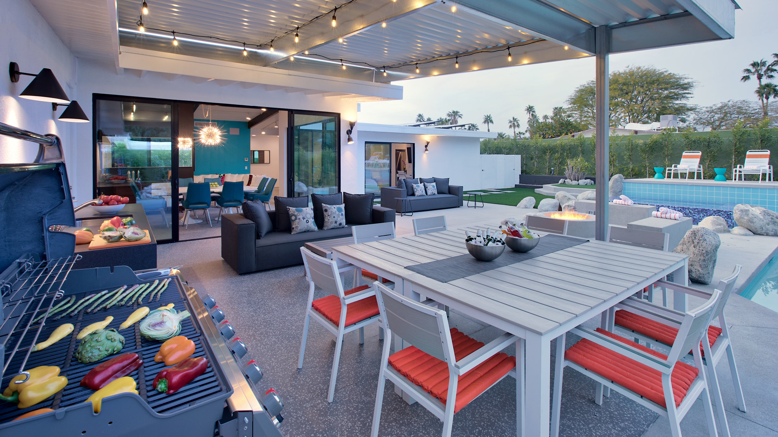 Covered outdoor dining/lounge. Gas grill and outdoor kitchenette