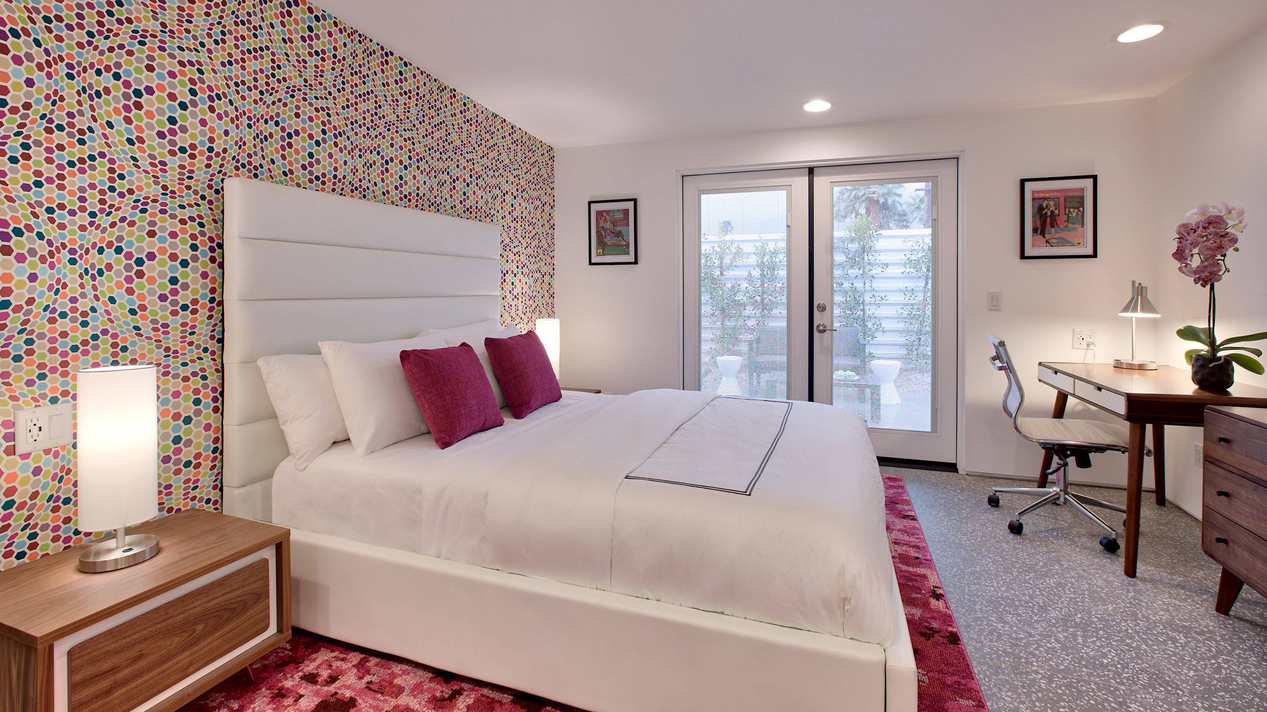 Bedroom #2: The Pink room- Queen size bed, en-suite bathroom, desk, and private outdoor patio. Fun and colorful wallpaper!