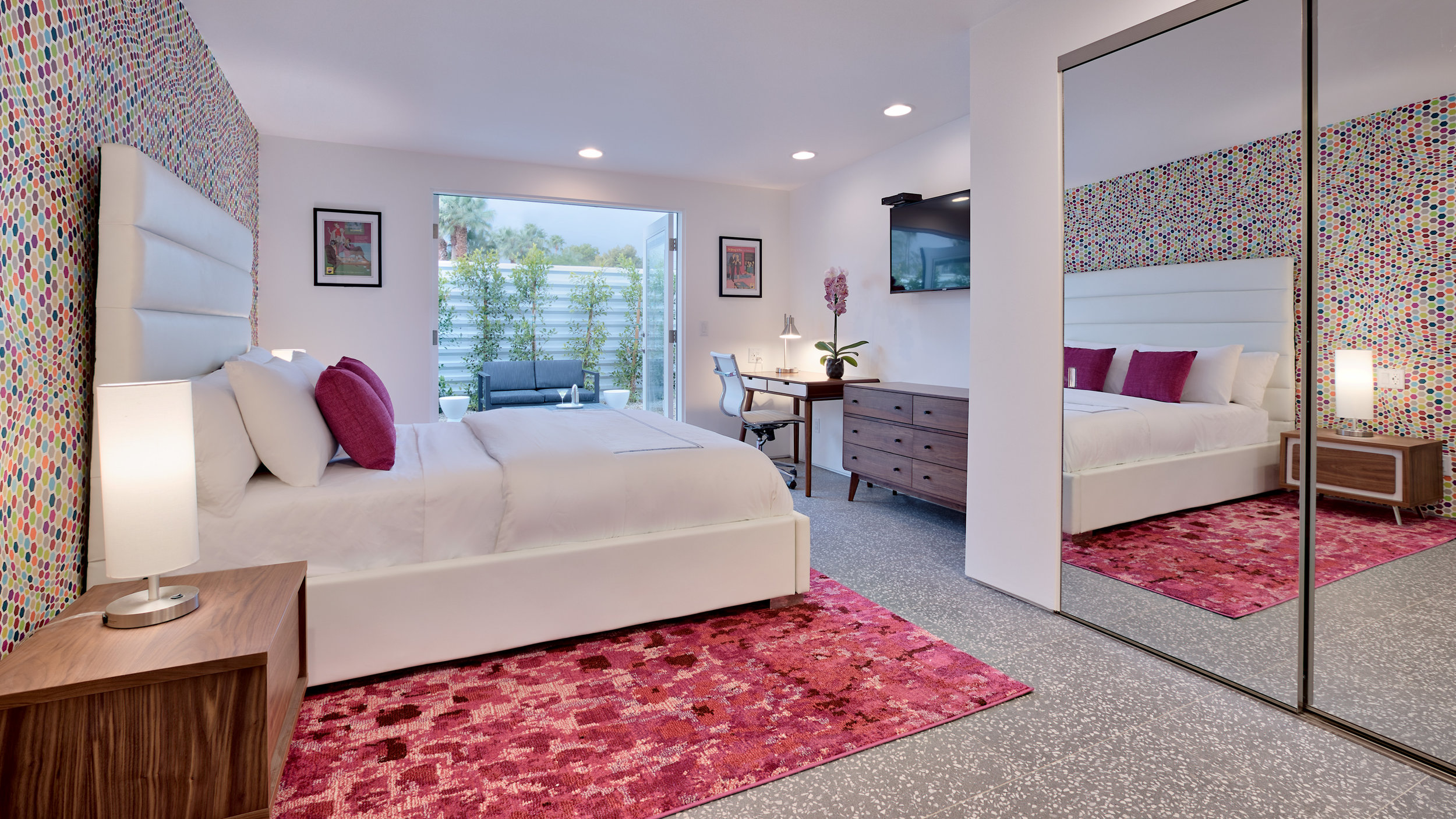 Bedroom #2: The Pink room- Queen size bed, en-suite bathroom, desk, and private outdoor patio.