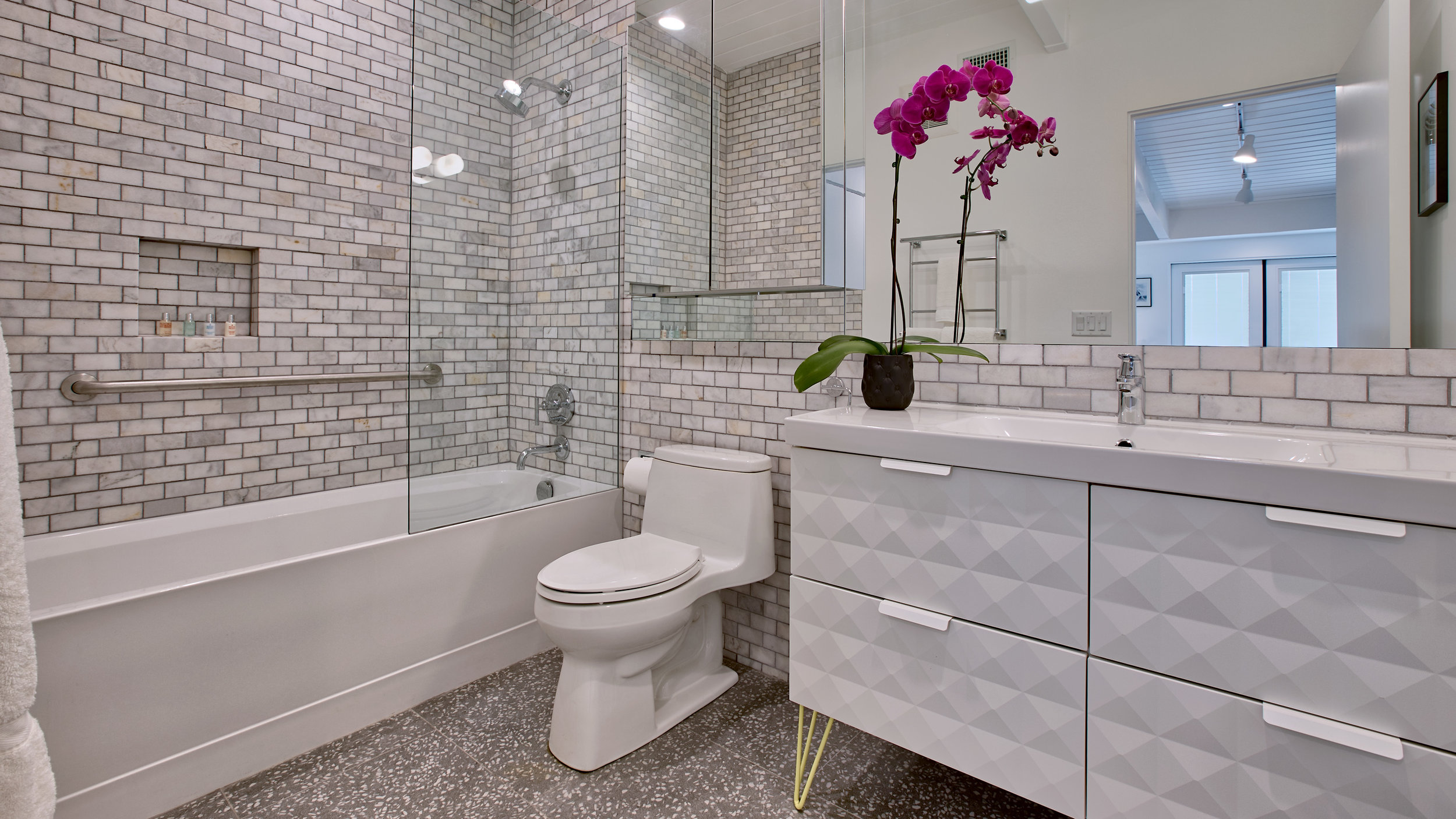 Bathroom #5: the yellow bedroom private bathroom. Marble tile, barrier shower over tub, large vanity....lots of room!