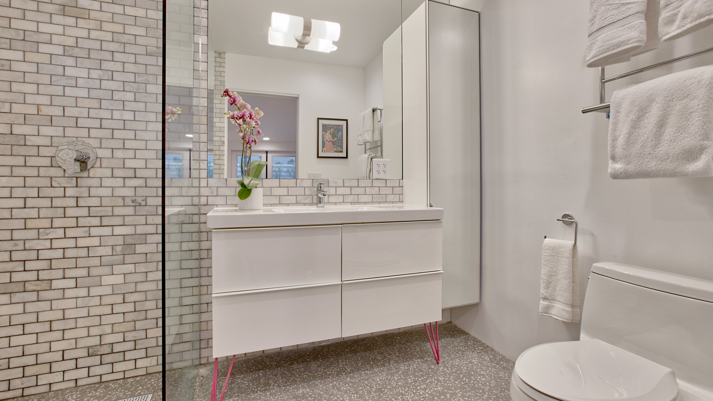Bathroom #2: the pink bedroom private bathroom. Marble tile, barrier free walk-in shower, large vanity....lots of room!