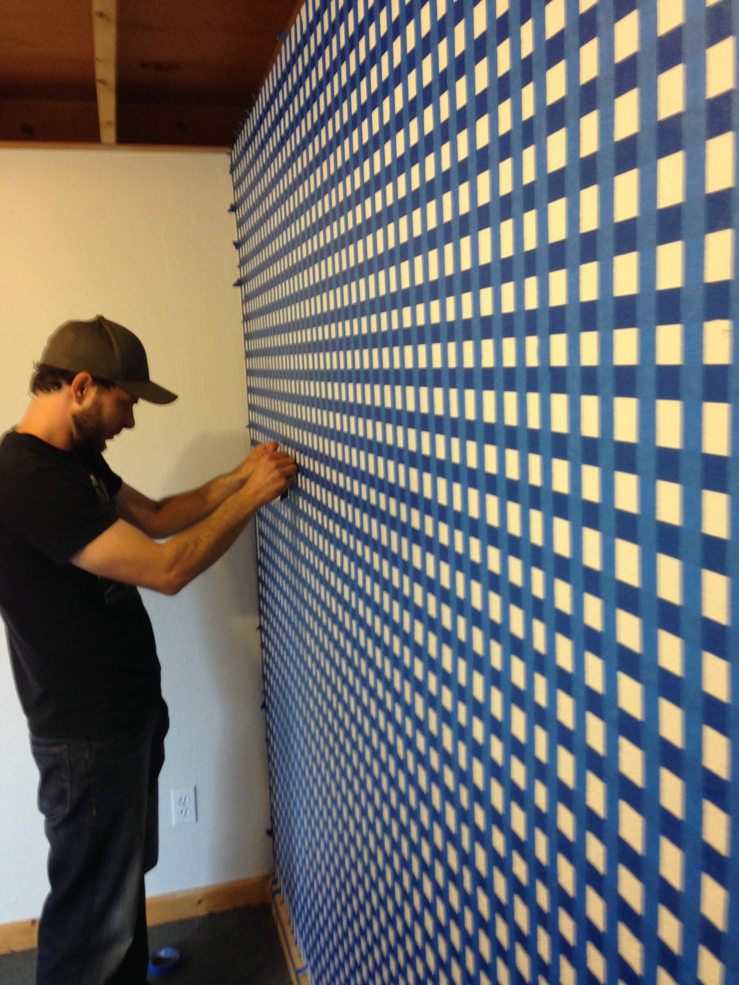 A wall in the studio was market with tape to create a reference grid