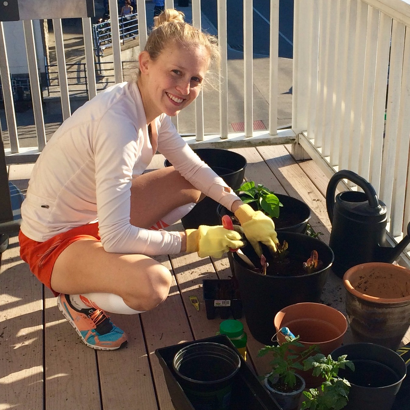 Planting my balcony garden - lots of herbs, tomatoes, peppers, and lettuce.