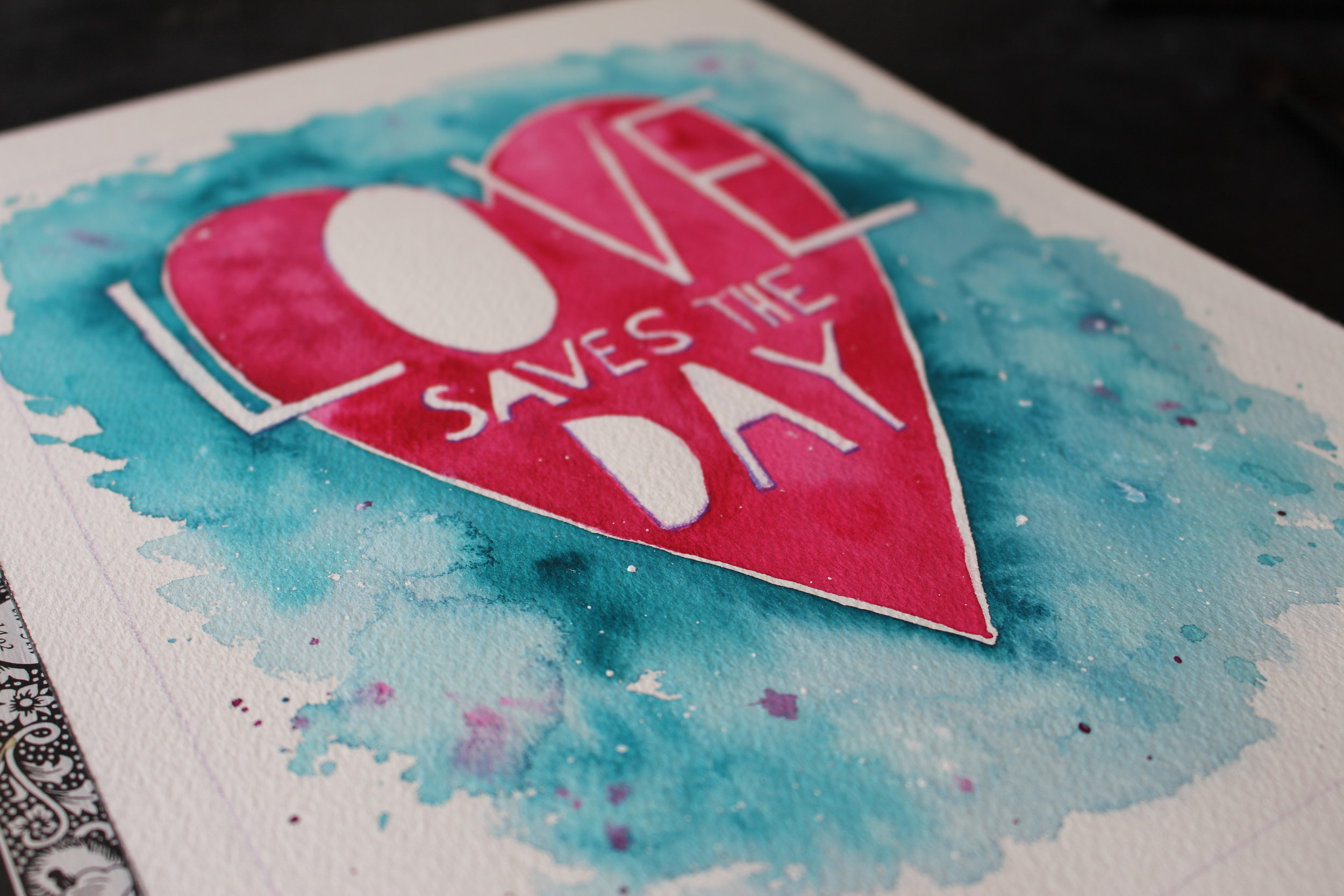 Create a fun heart and learn how to add lettering to your watercolor design!