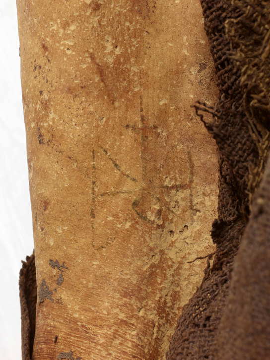 This woman from the Sudan died around 700 AD and was naturally mummified after she was buried in the desert. She has the monogram of St. Michael tattooed on her thigh. © Trustees of the British Museum.