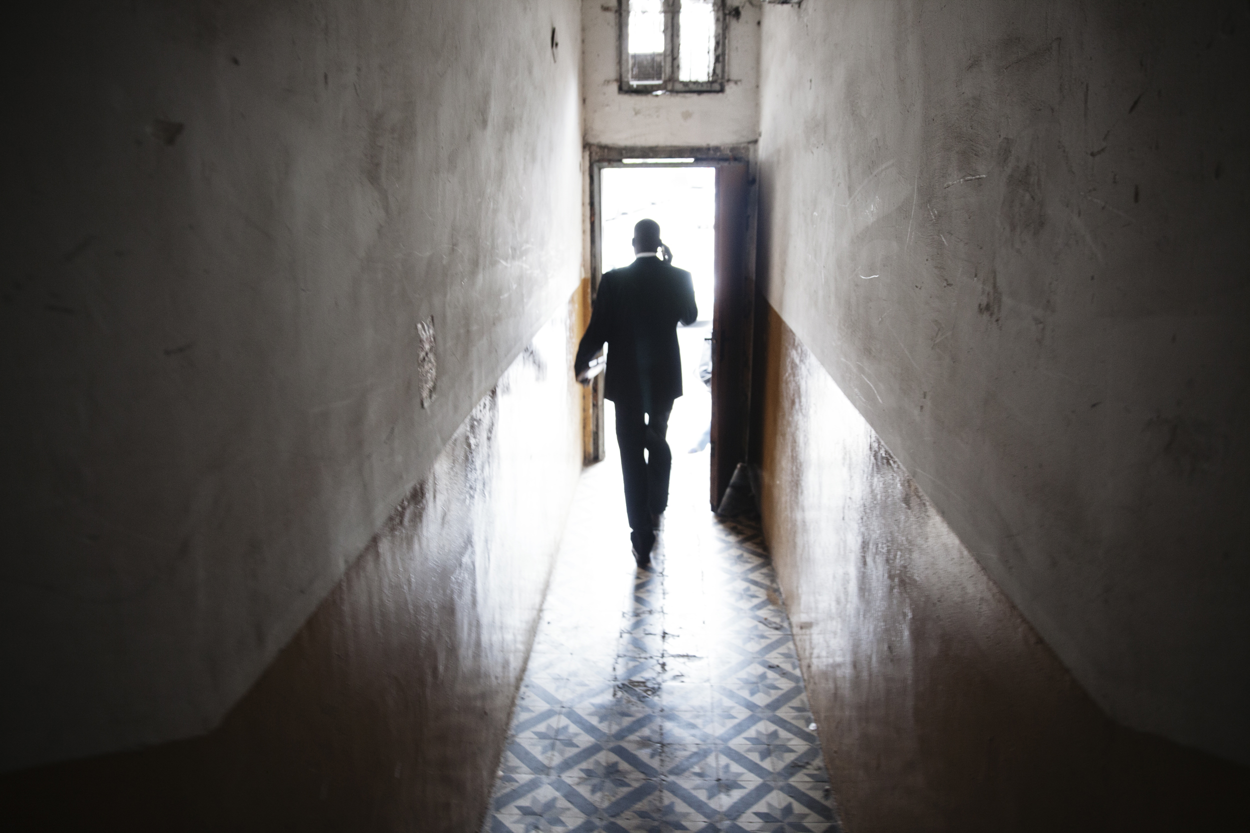"""Mutasim Ali, an asylum-seeker from Sudan is leaving his home to appear in district court in Tel Aviv, Israel. He is appealing his """"invitation"""" to Holot detention center."""