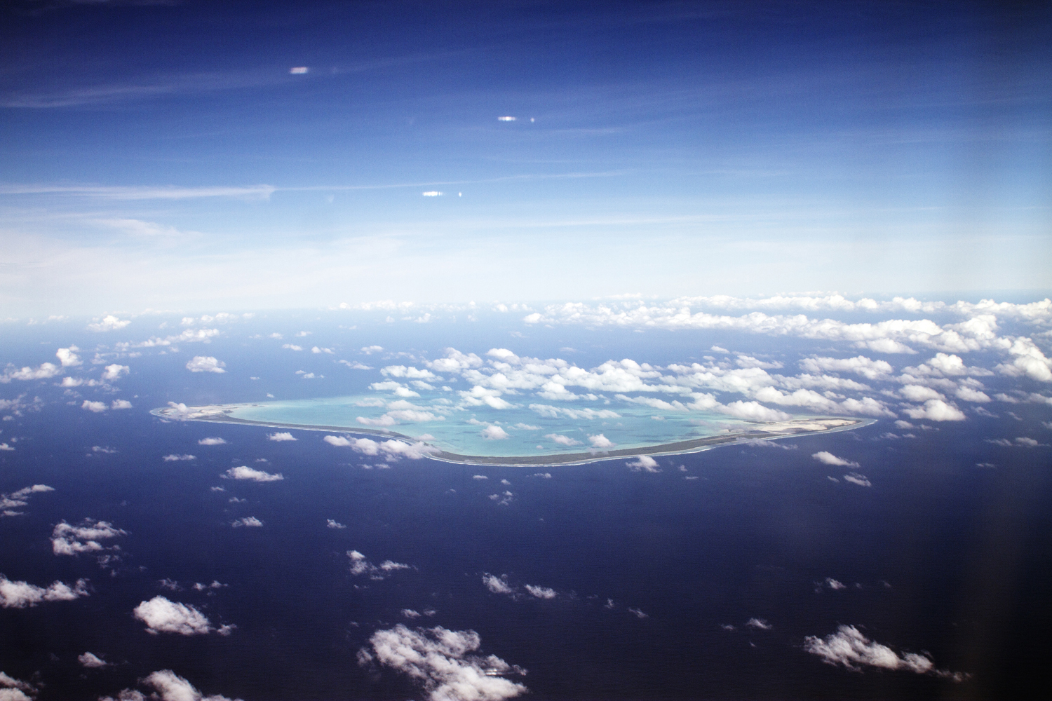VANISHING NATION. Overview shot of Maiana Island which is one of the 33 low lying islands of Kiribati. The average height above sea level for the island is less than 3 meters. 2010.