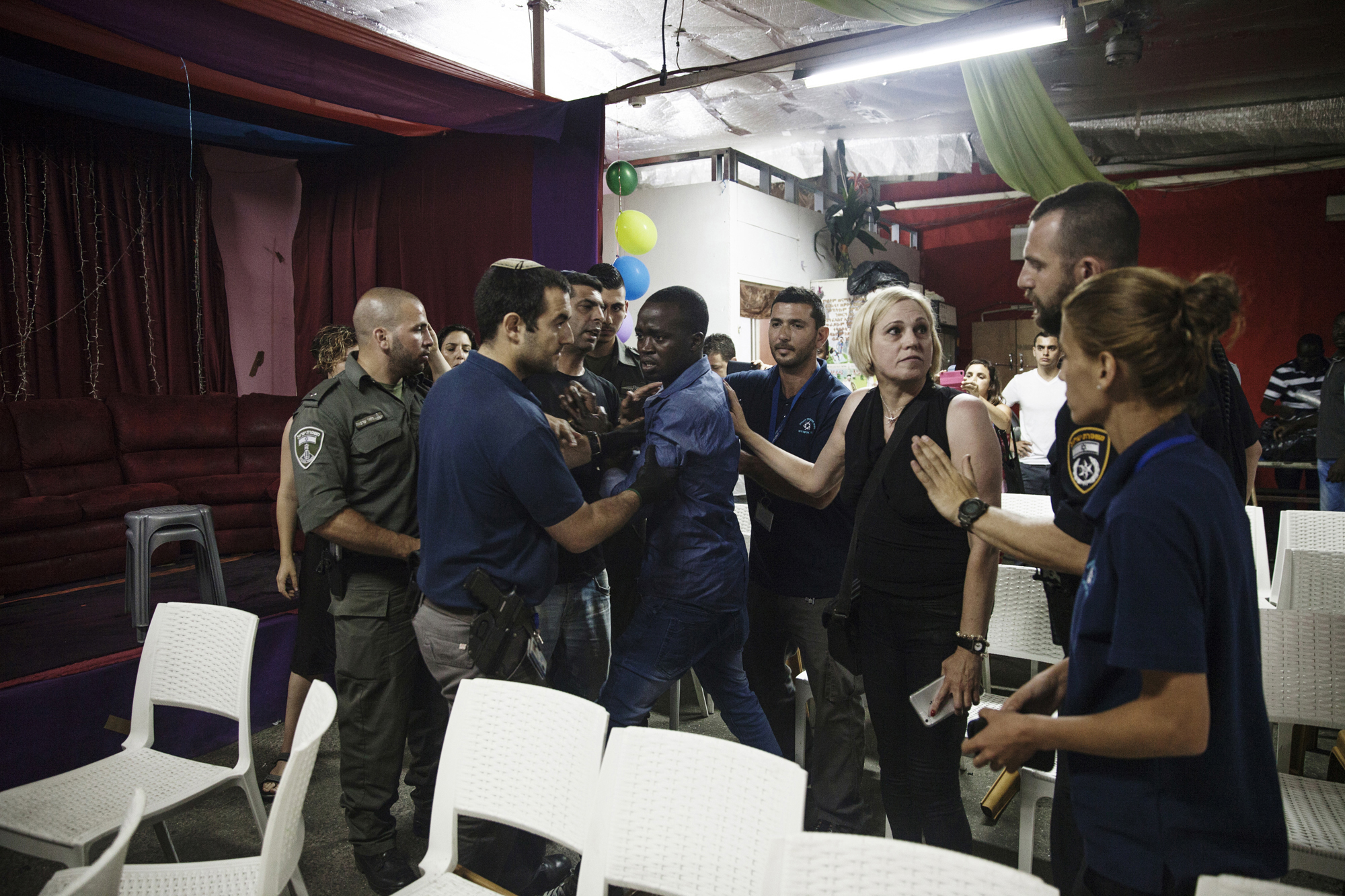 Police officers arrested an asylum seeker at a graduation party for Taj Jemy, another asylum seeker, while an Israeli activist tried to intervene. Seven people were arrested that night for not having visas on them.