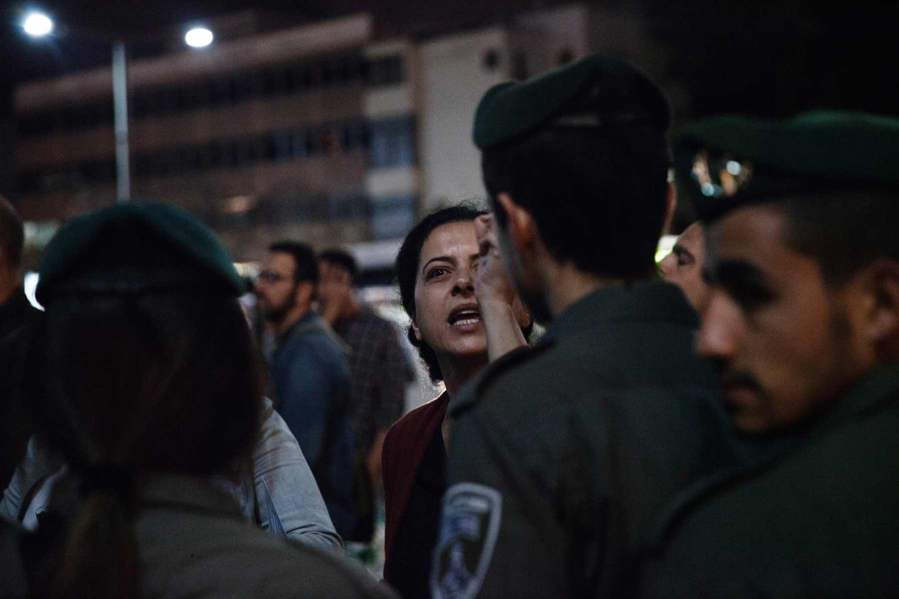 An anti-refugee protester argued with border police officers at a demonstration in Tel Aviv.