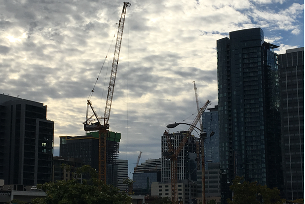A flock of tower cranes have descended upon downtown Seattle with a record number of construction projects in motion.