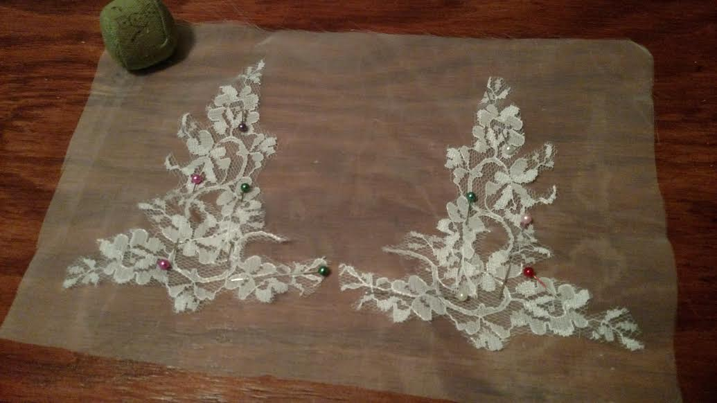 Lace from the reception dress on organza to create lace hand appliques