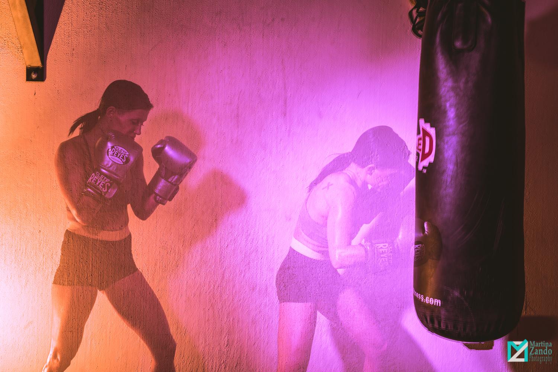 double exposure female boxer hitting bag