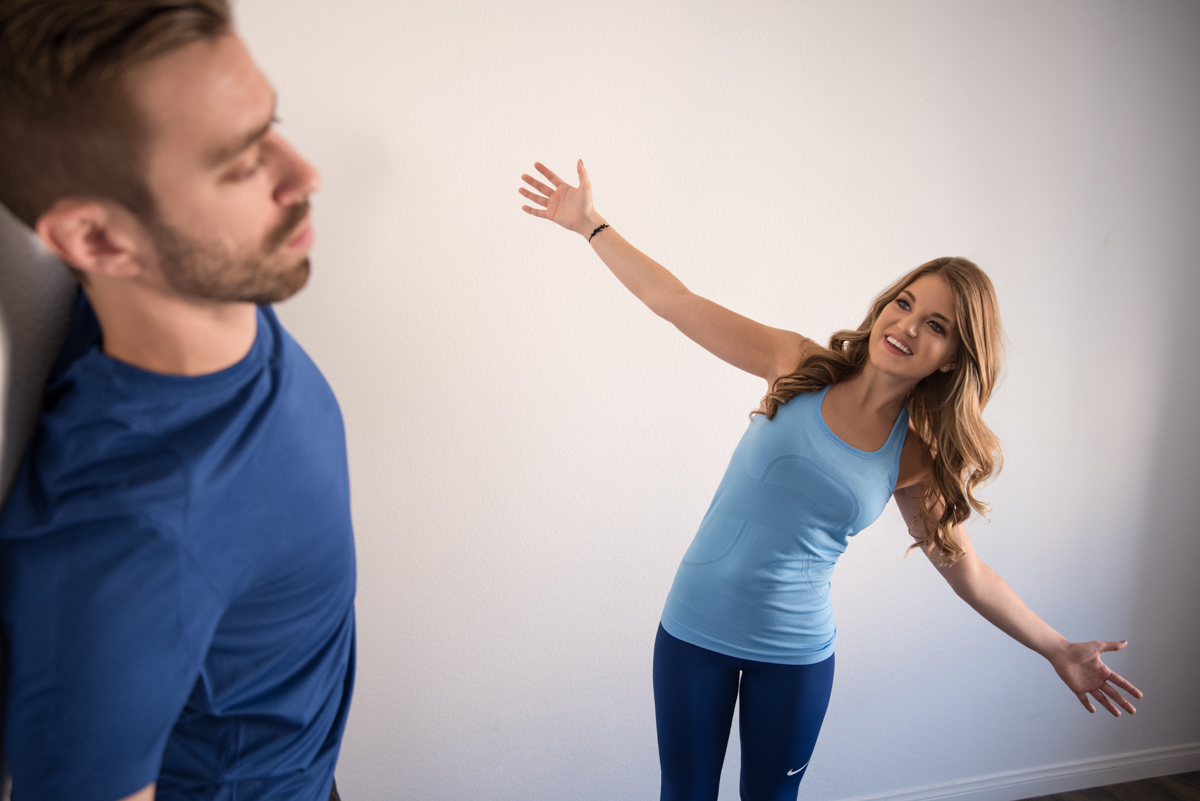 Exercise therapist demonstrate movement to client