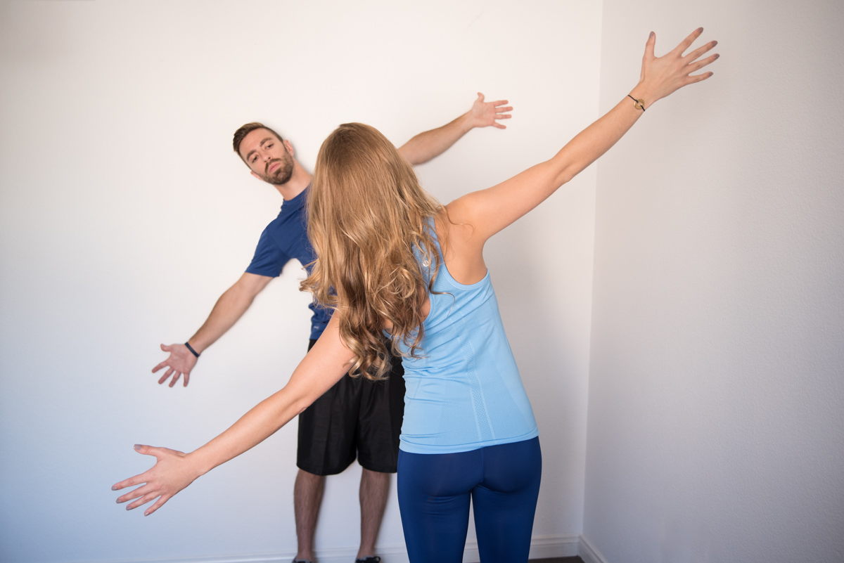 exercise therapist shows movement to client