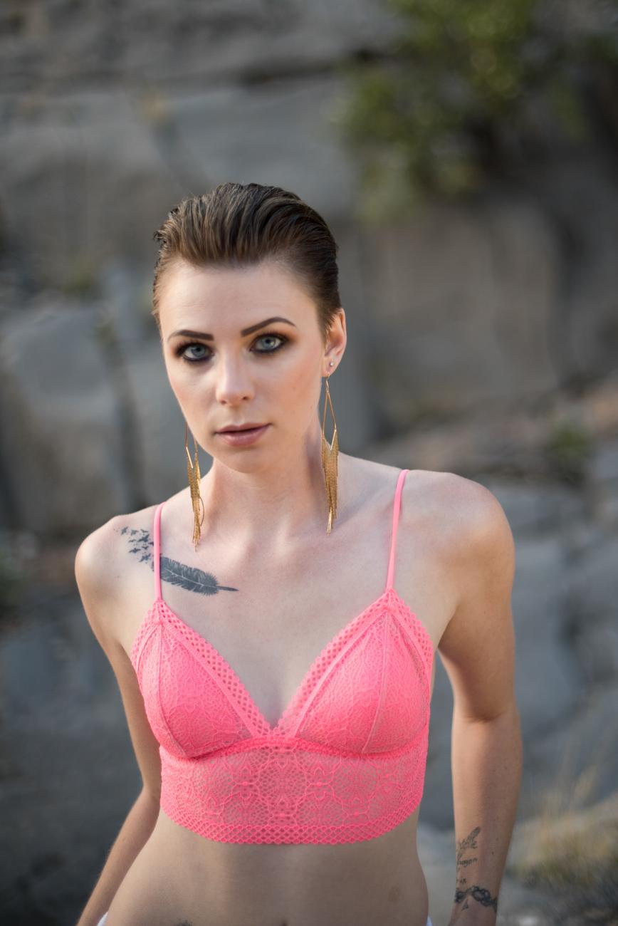 pink bralette striking woman blue eyes boudoir photo
