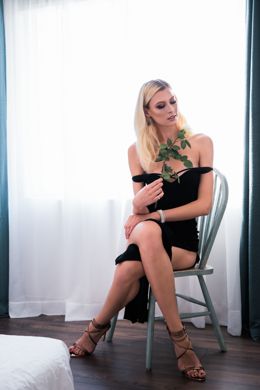 Editorial Boudoir model with elegant dress and rose